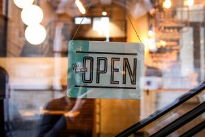 we are open sign hanging on storefront