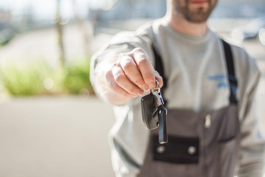 man handing over keys